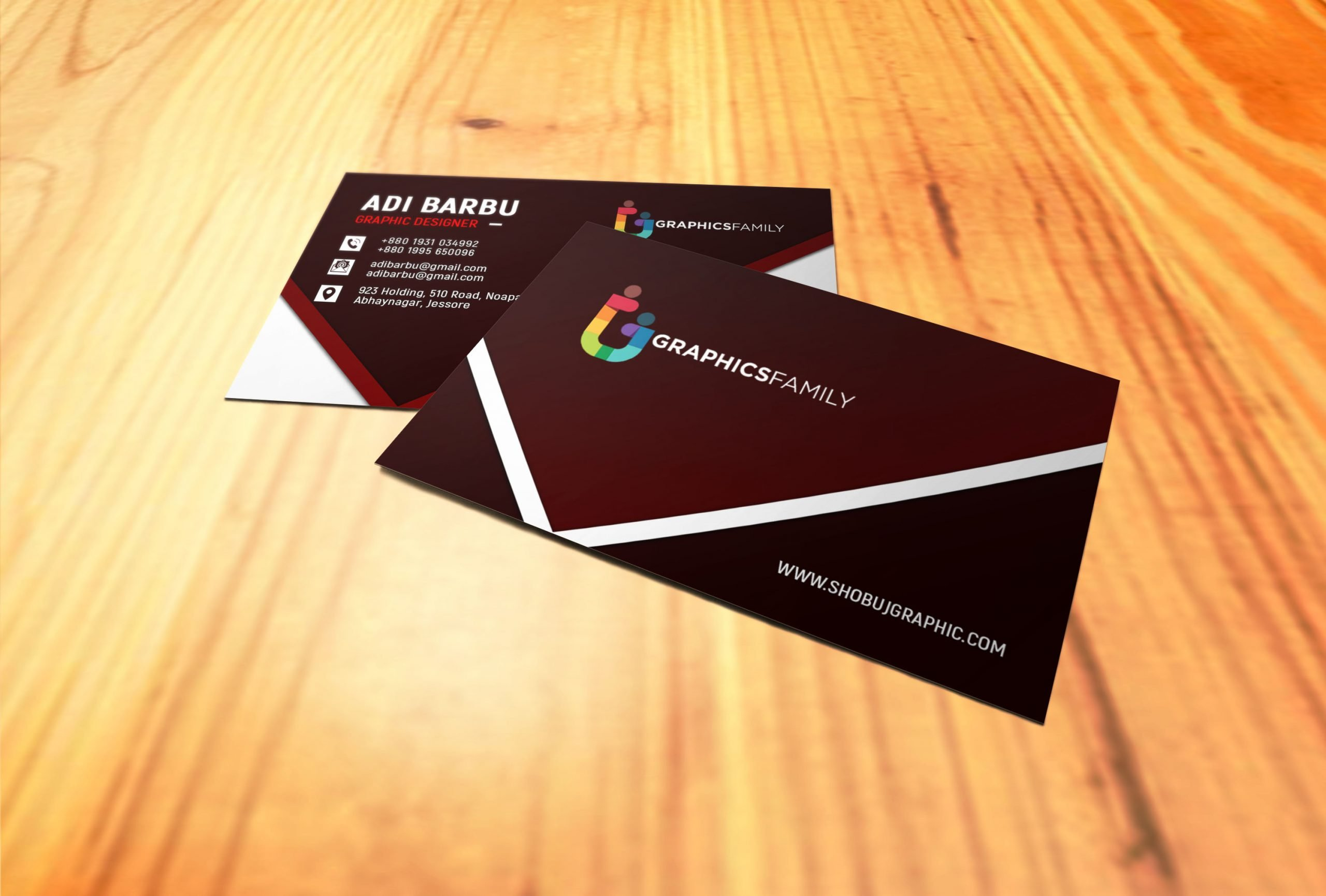 Free Photoshop Graphic Design Business Card on wood mockup