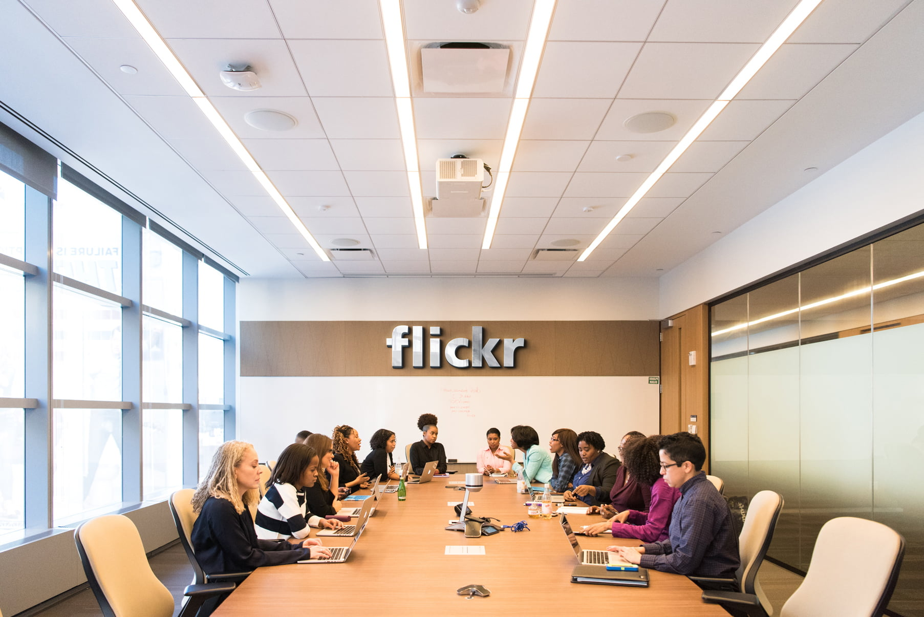 Flickr Board Meeting Room Logo Mockup by GraphicsFamily