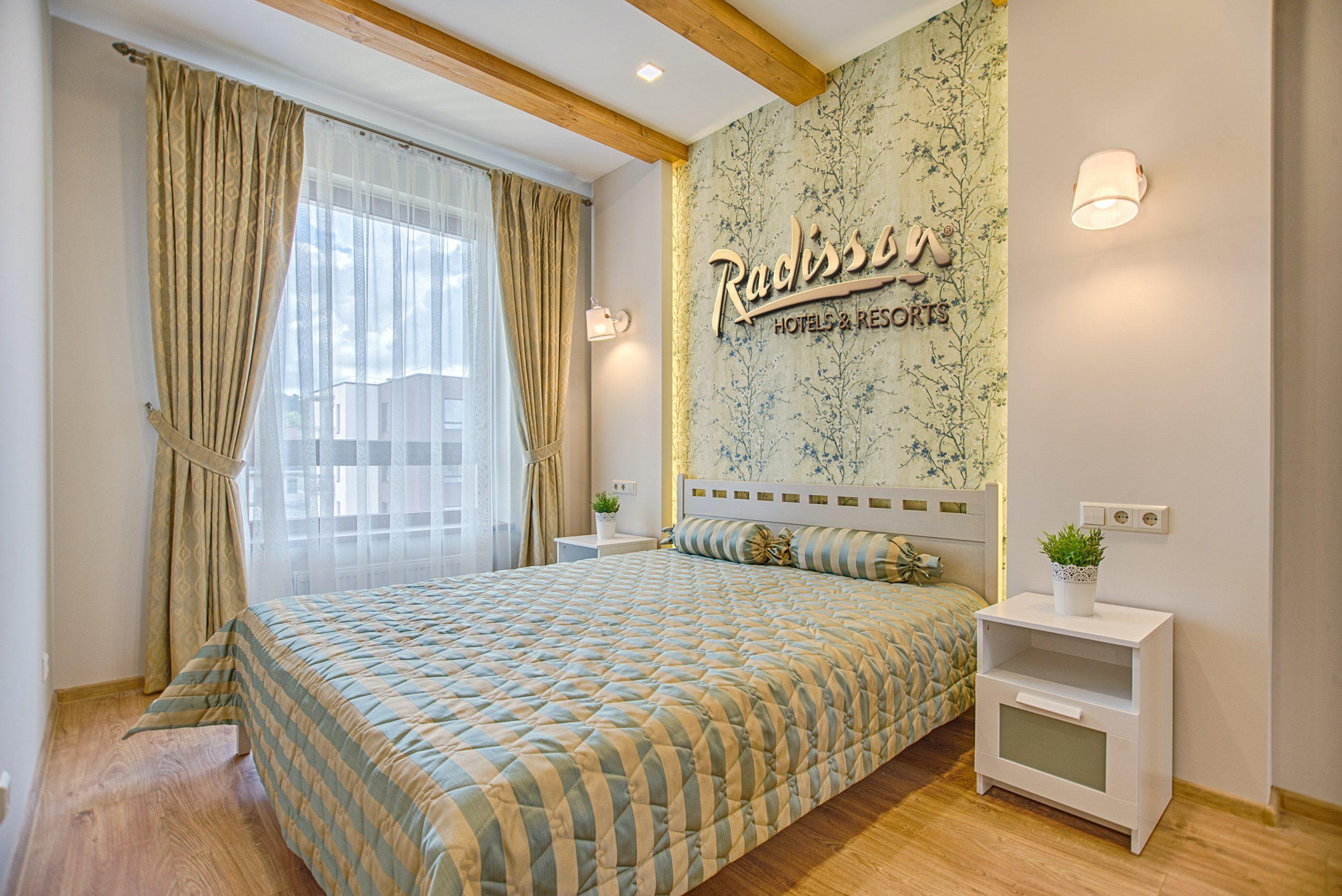 Radisson Free Luxury Hotel Room Logo Mockup
