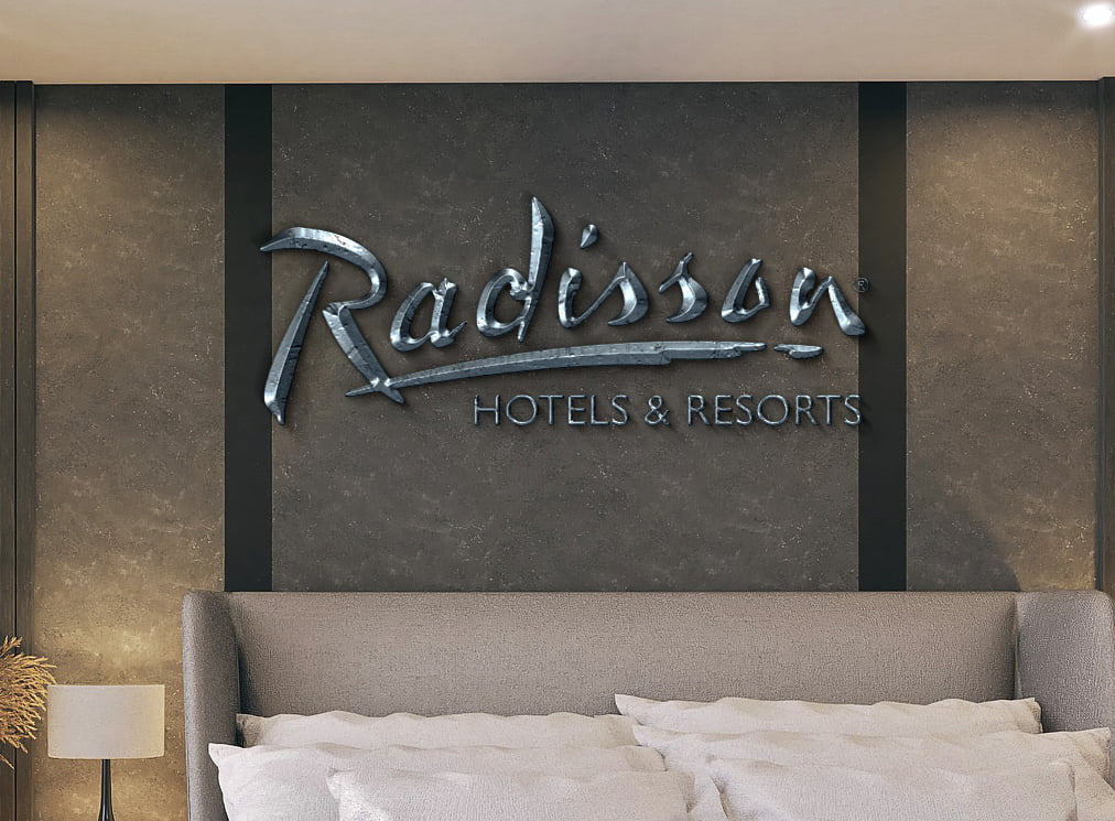Radisson-Room- With King Bed Logo Mock-up by GraphicsFamily