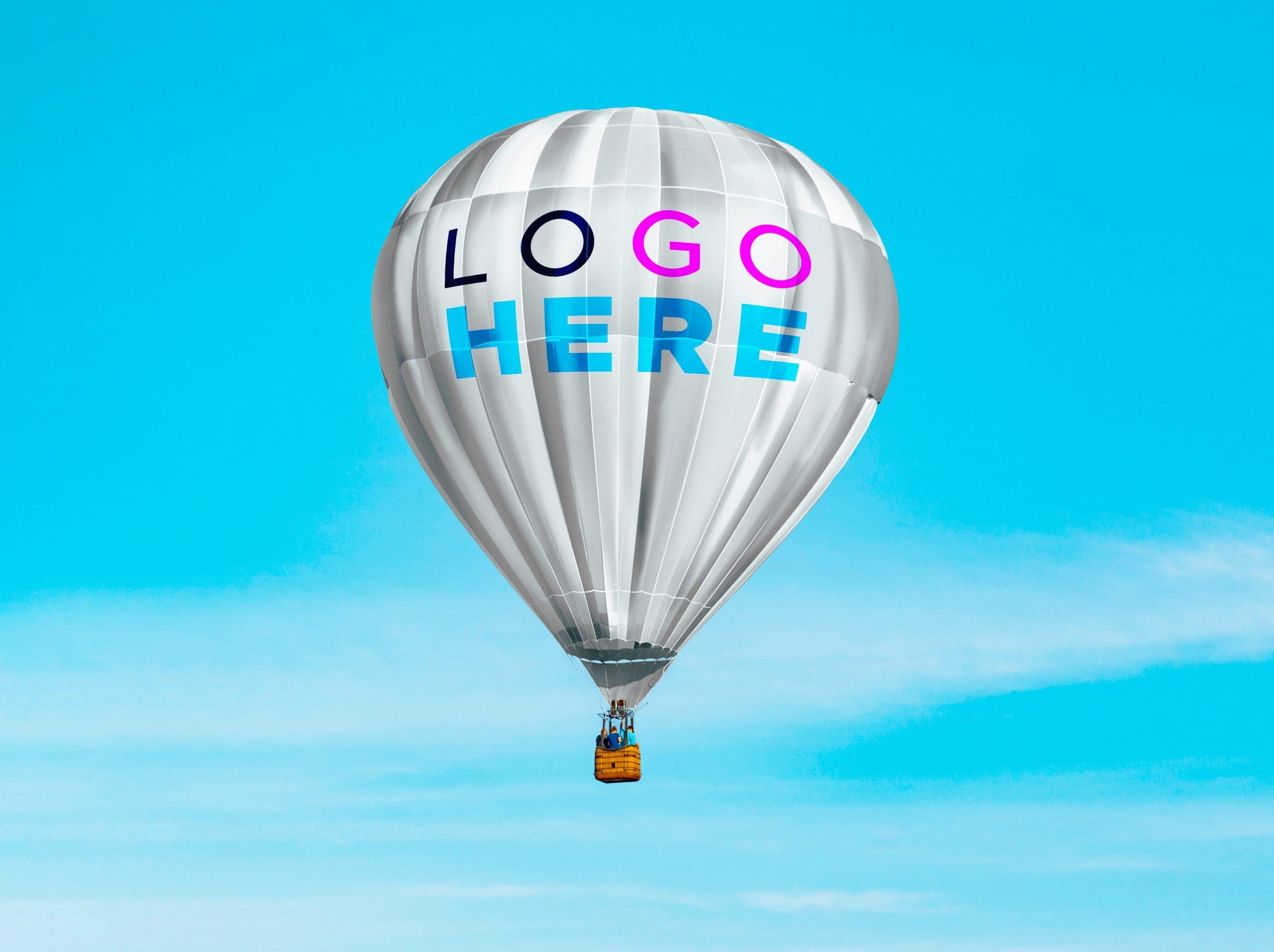 Free Hot Air Baloon Logo Mockup by GraphicsFamily