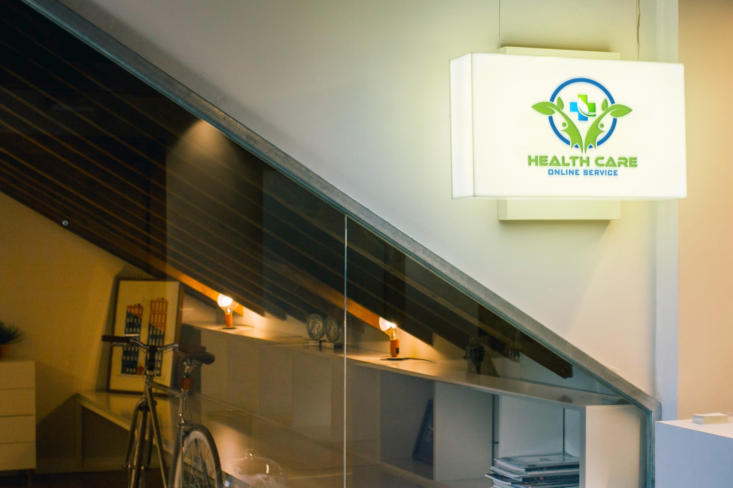 Health-Care-Hanging-Wall-Sign-Logo-Mockup
