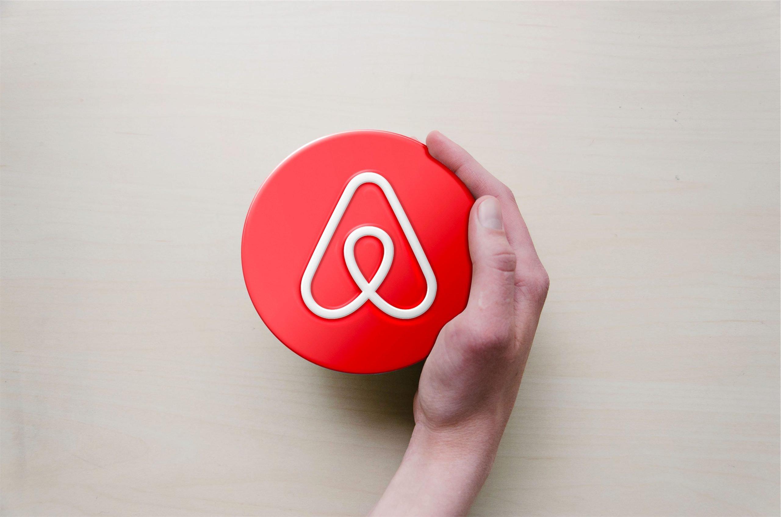 Circle with Hand Logo Mockup Airbnd