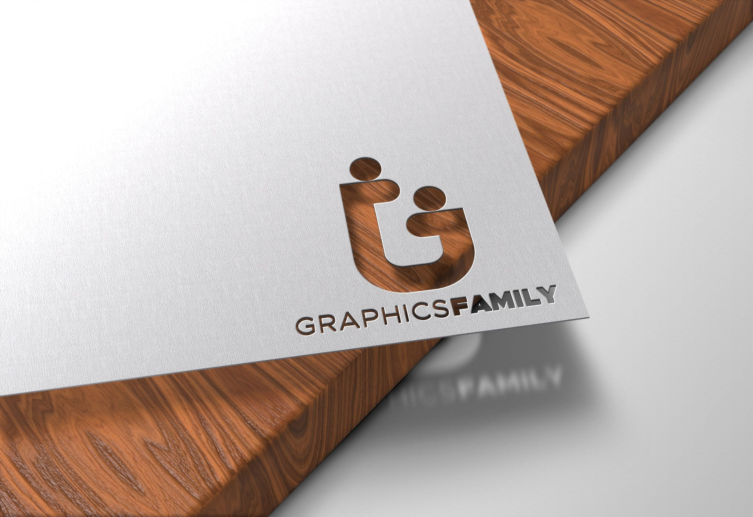 GraphicsFamily-Paper-Cutout-on-Wood-Logo-Mockup