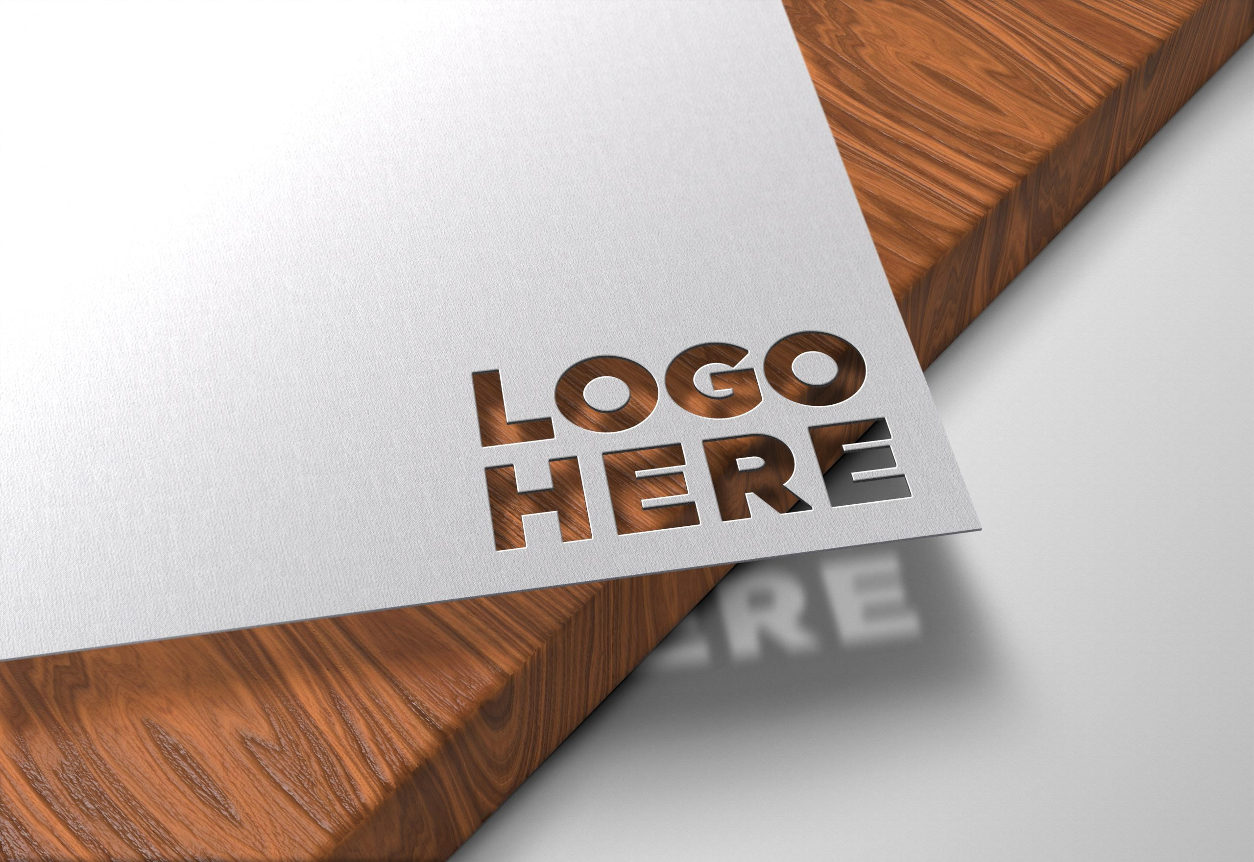 Logo-Here-Paper-Cutout-on-Wood-Logo-Mockup
