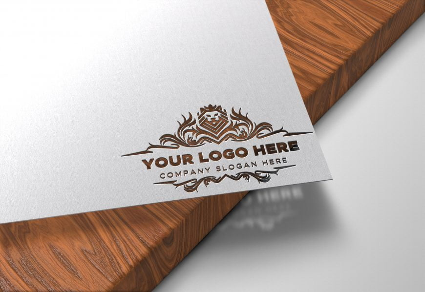Logo-Here-Paper-Cutout-on-Wood-Logo-Mockup-by-GraphicsFamily