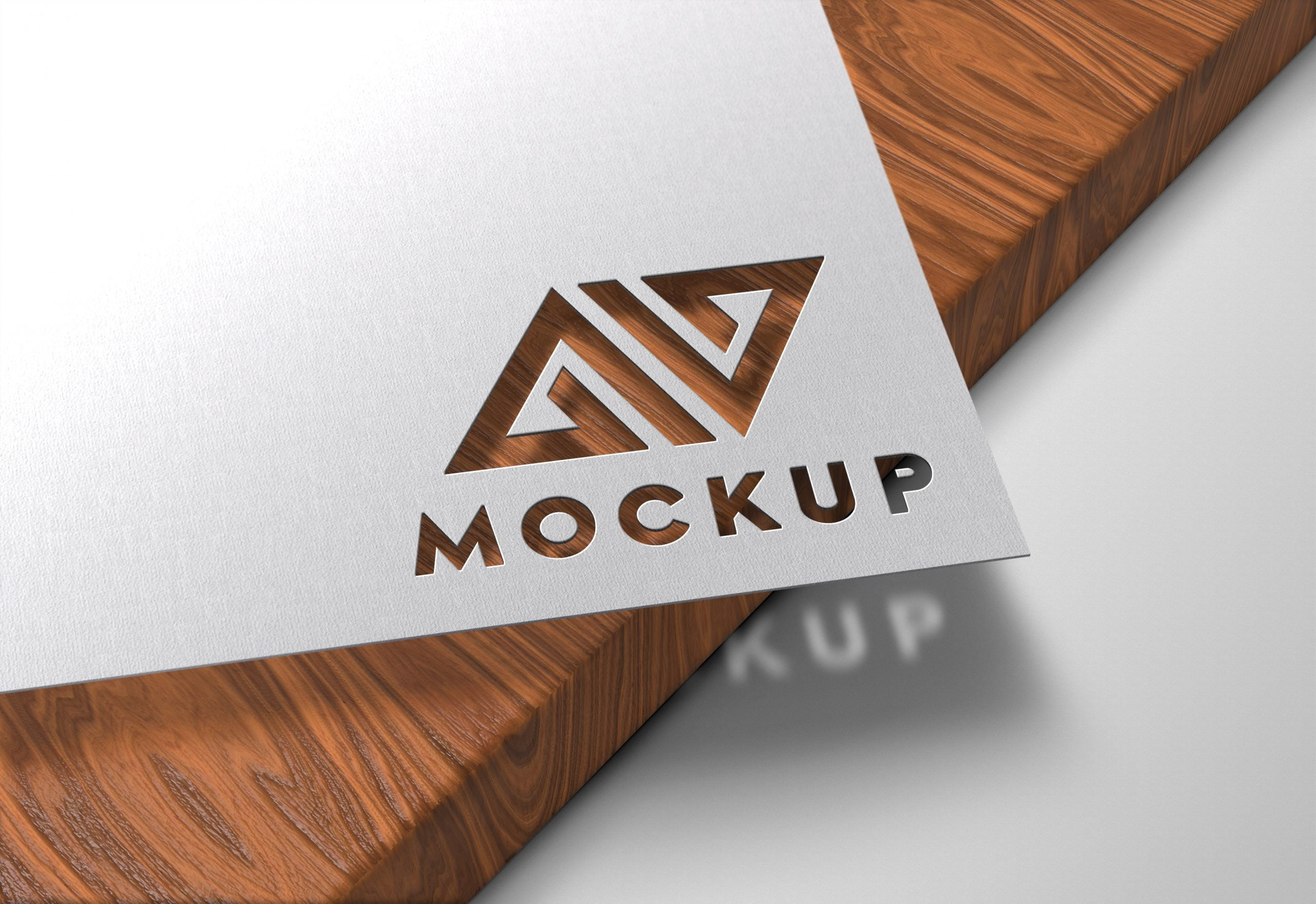 Paper-Cutout-on-Wood-Logo-Mockup-by-GraphicsFamily