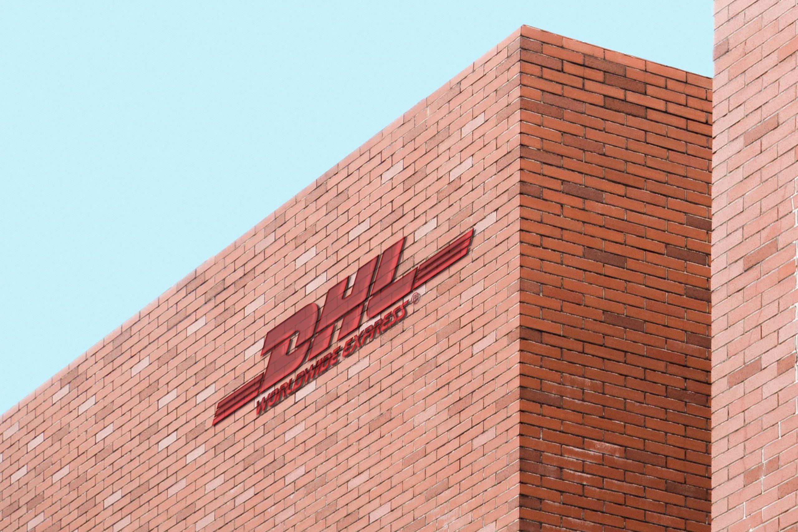 Free Glass Logo Brick Building Mockup